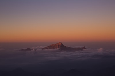 mountain covered by clouds during sunset saudi arabia teams background