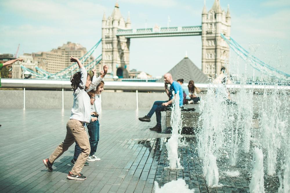 children playing near fountain