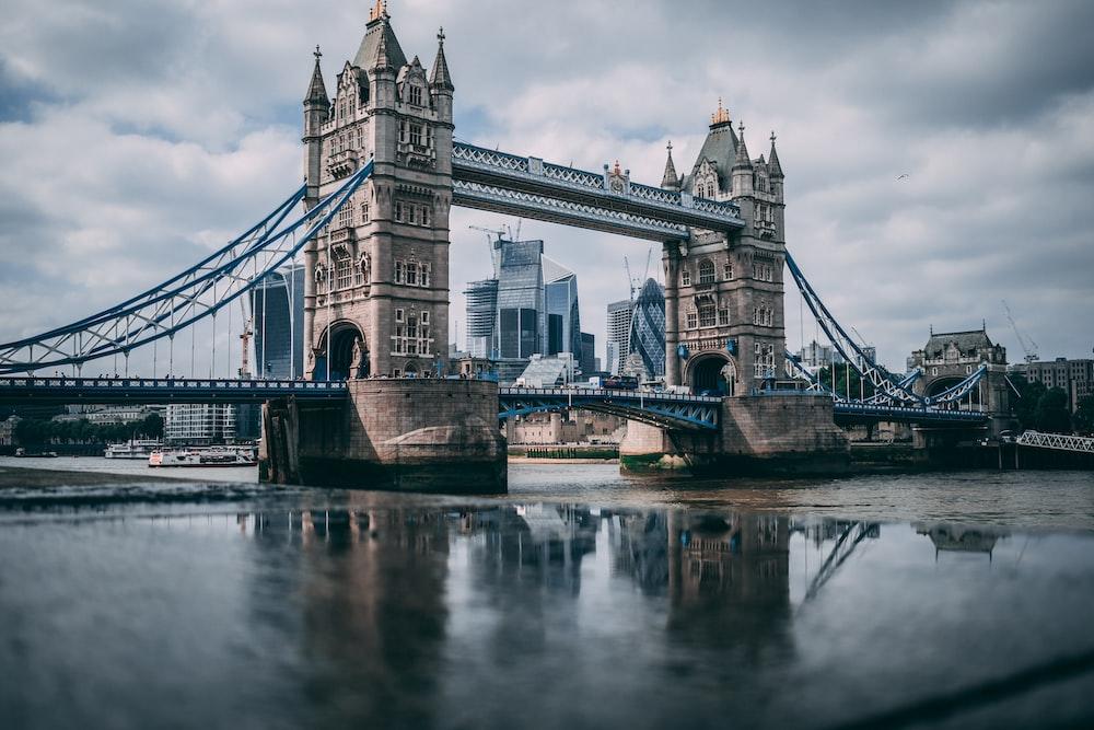 London Tower Bridge taken under white clouds during daytime