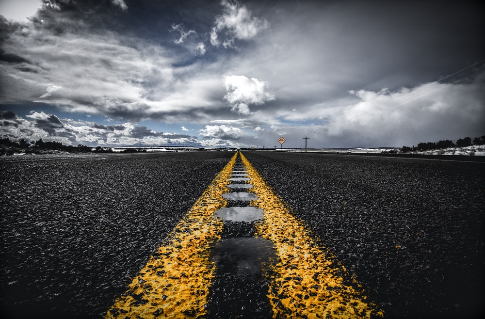 road with yellow road maker