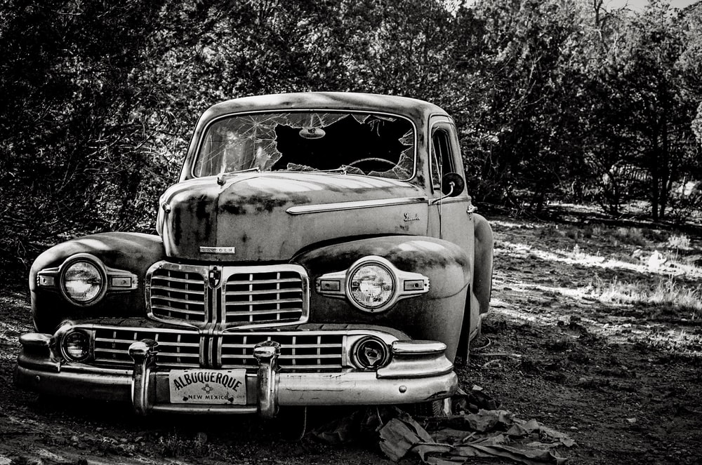 classic vehicle parked near trees