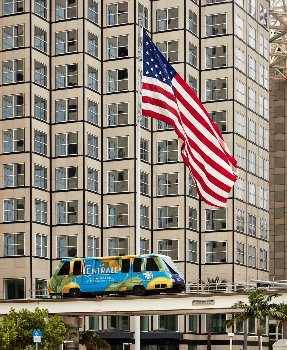 Centrale bus passing through on bridge near USA flag