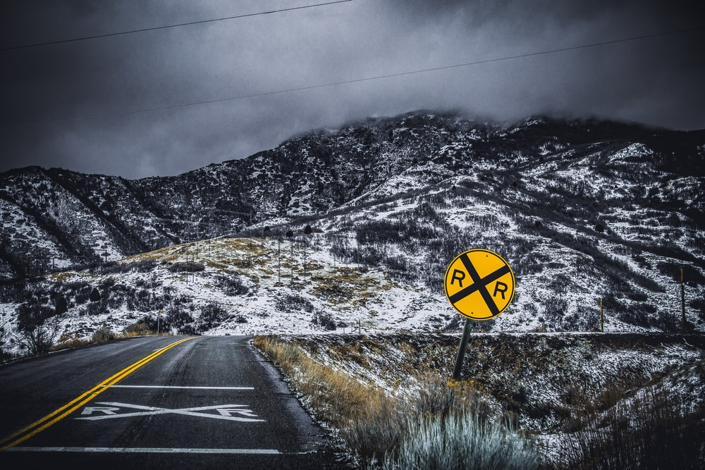 yellow and black road signage on roadside