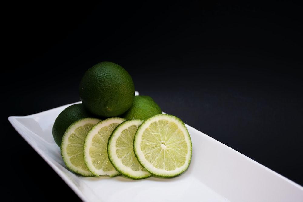 sliced lemons on white tray