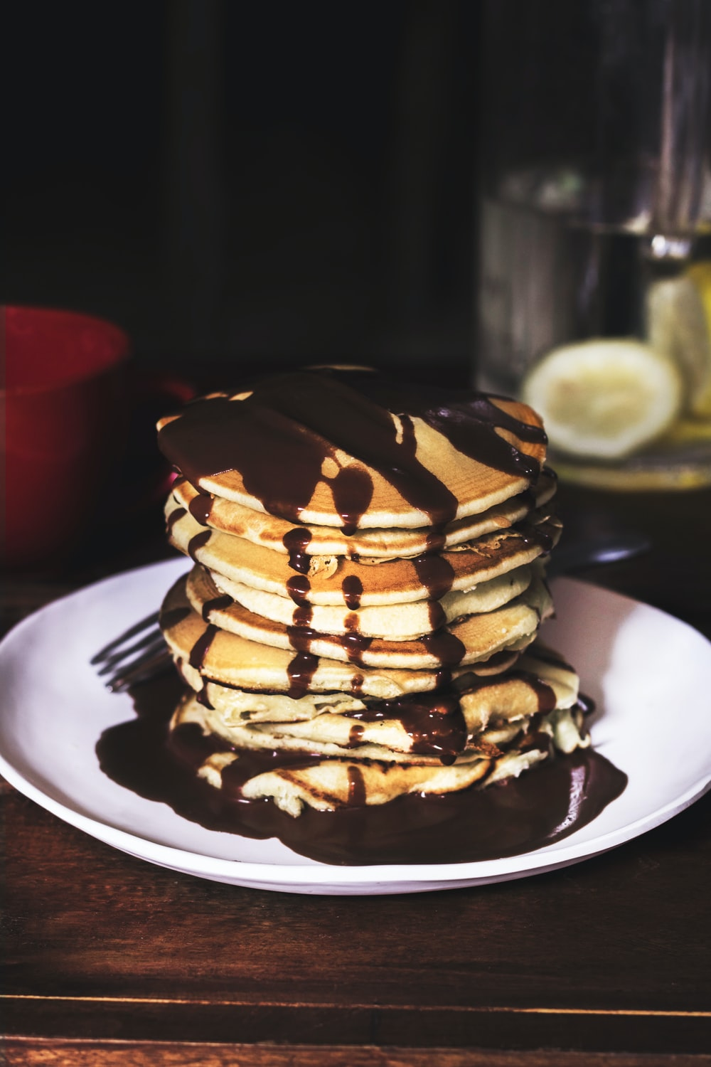 pancake on round plate with chocolate syrup