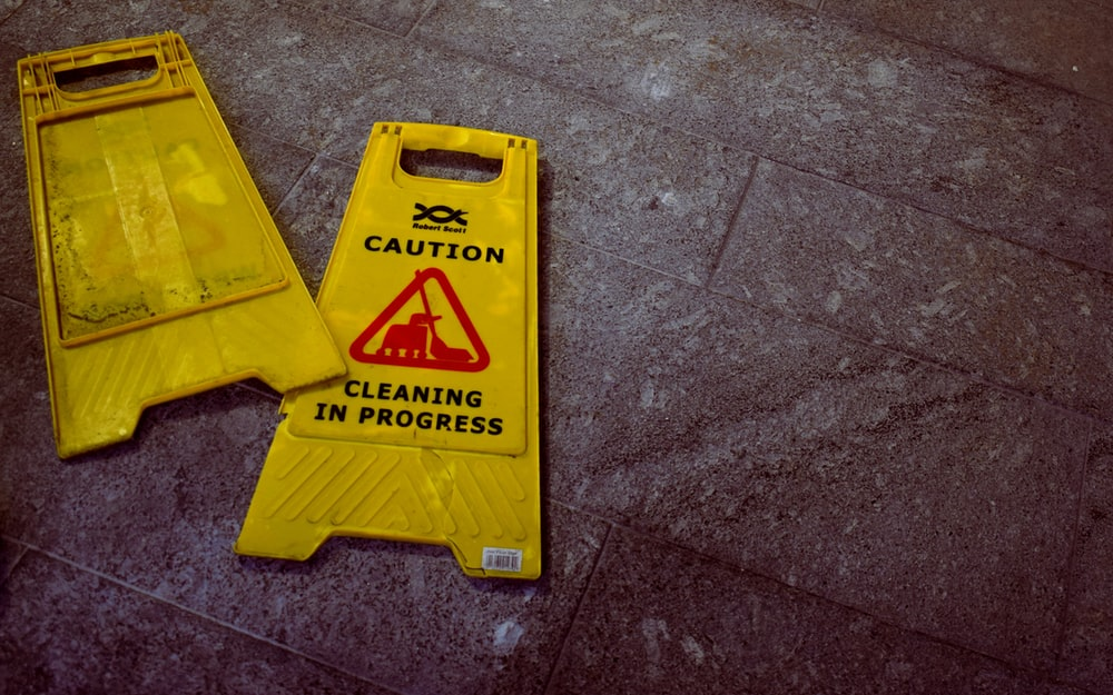 two Caution Cleaning signs by Oliver Hale