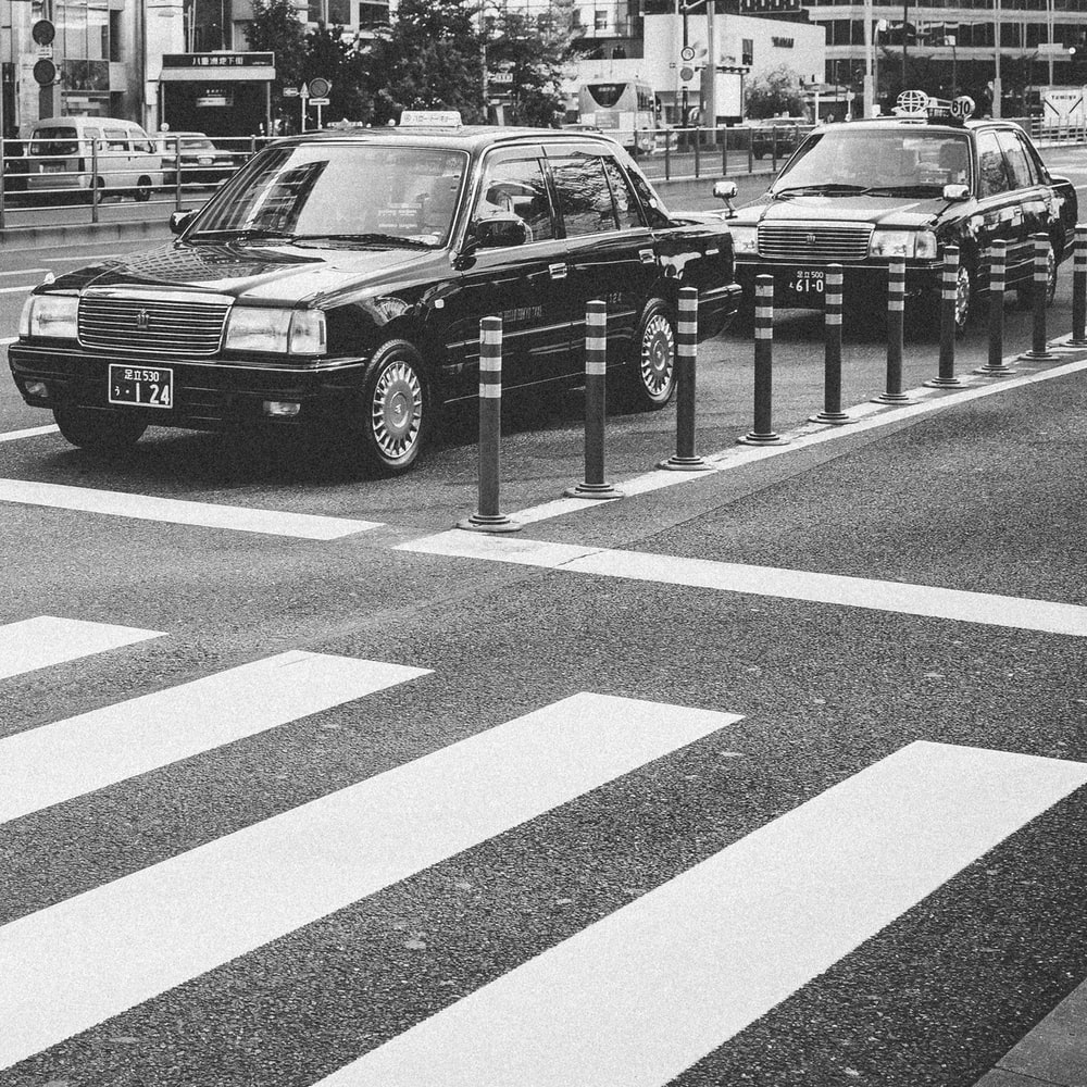 two sedan parked on asphalt road