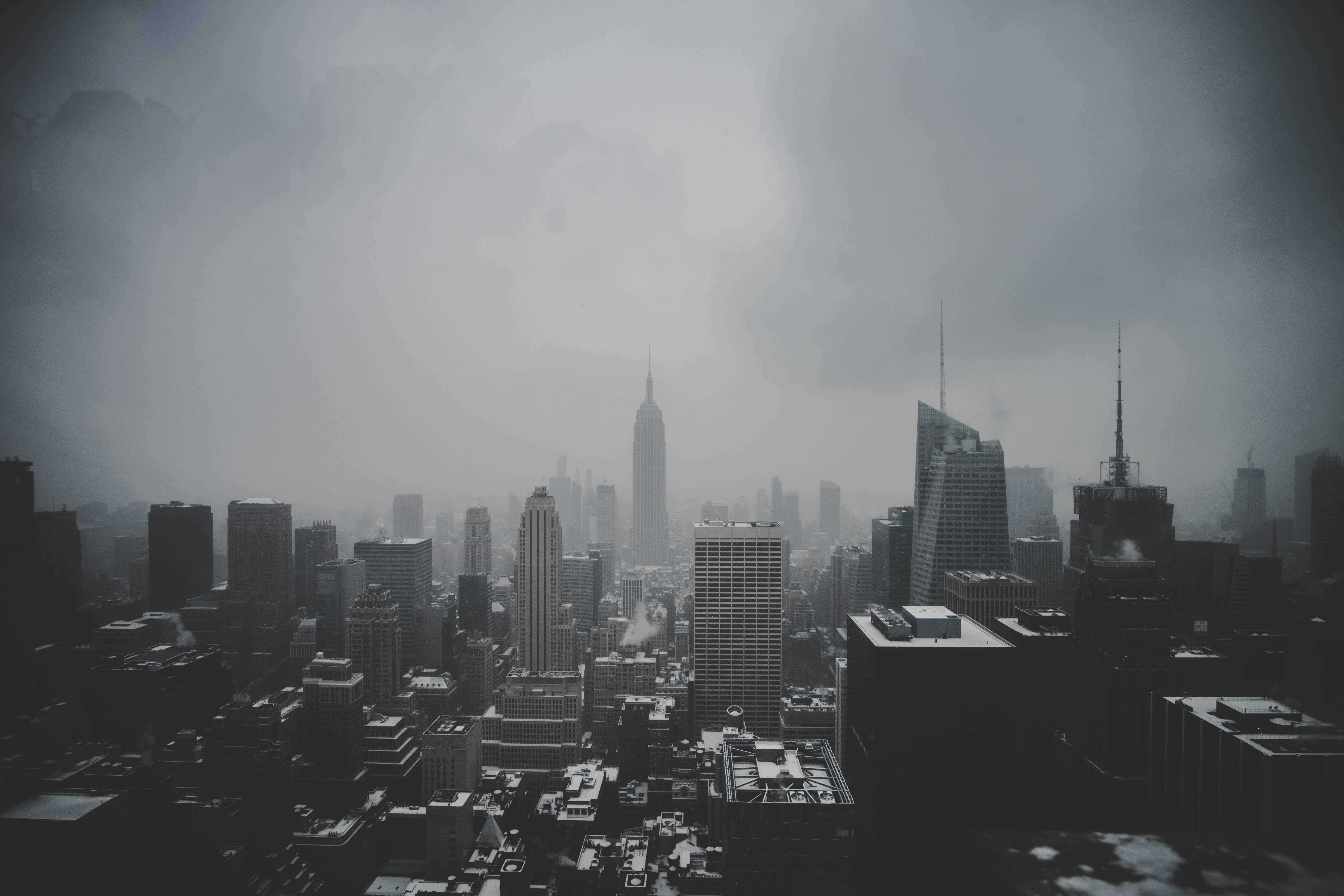high-rise buildings under the cloudy sky