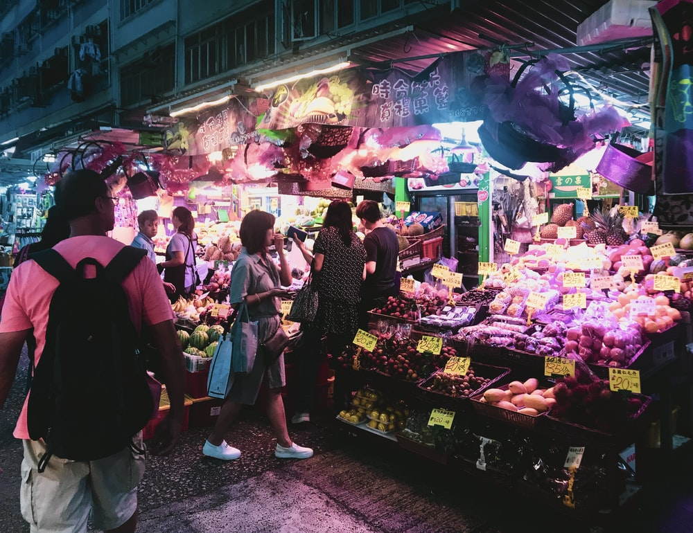 people standing at the market during nighttime