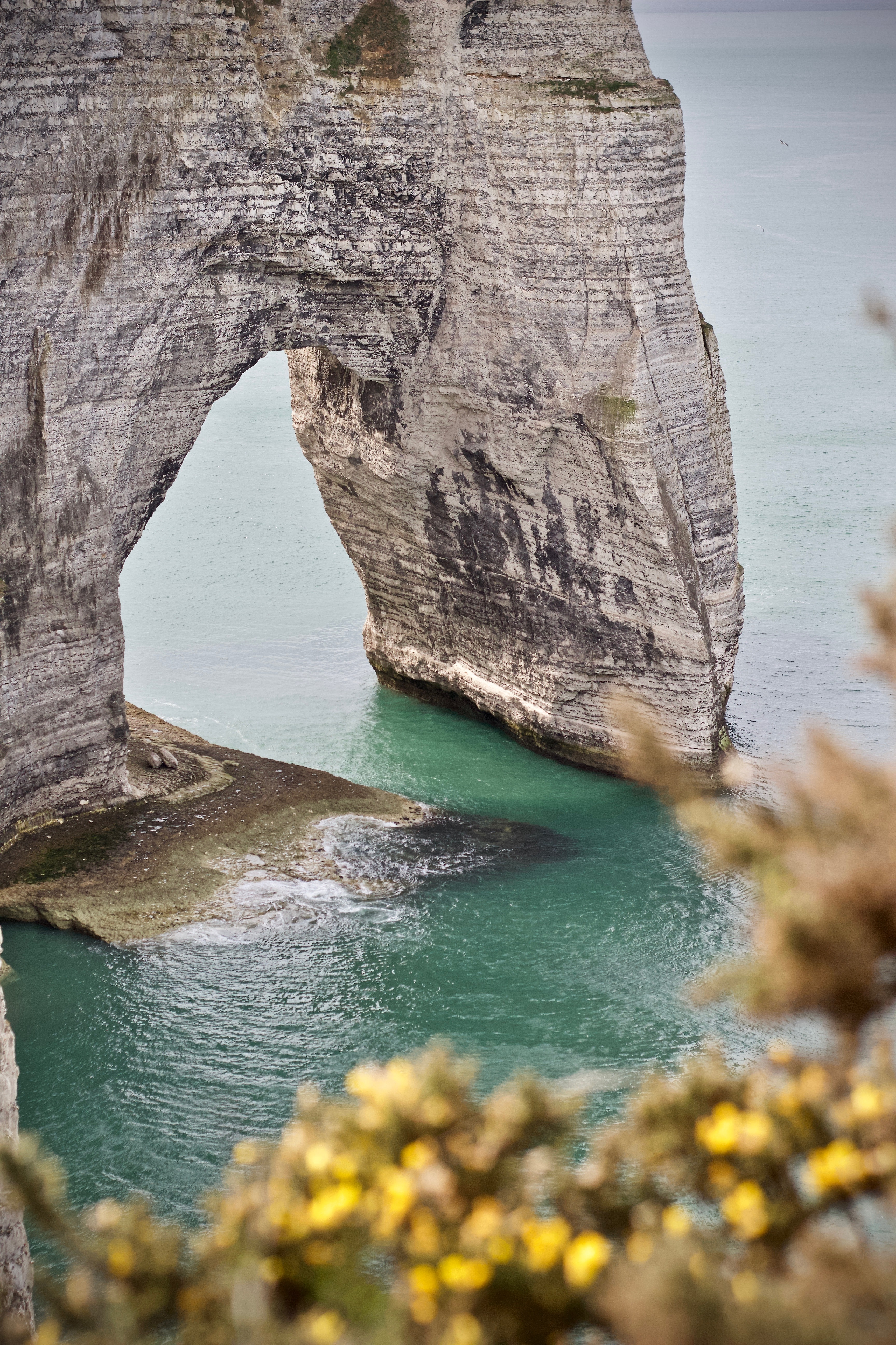 rock monolith on body of water