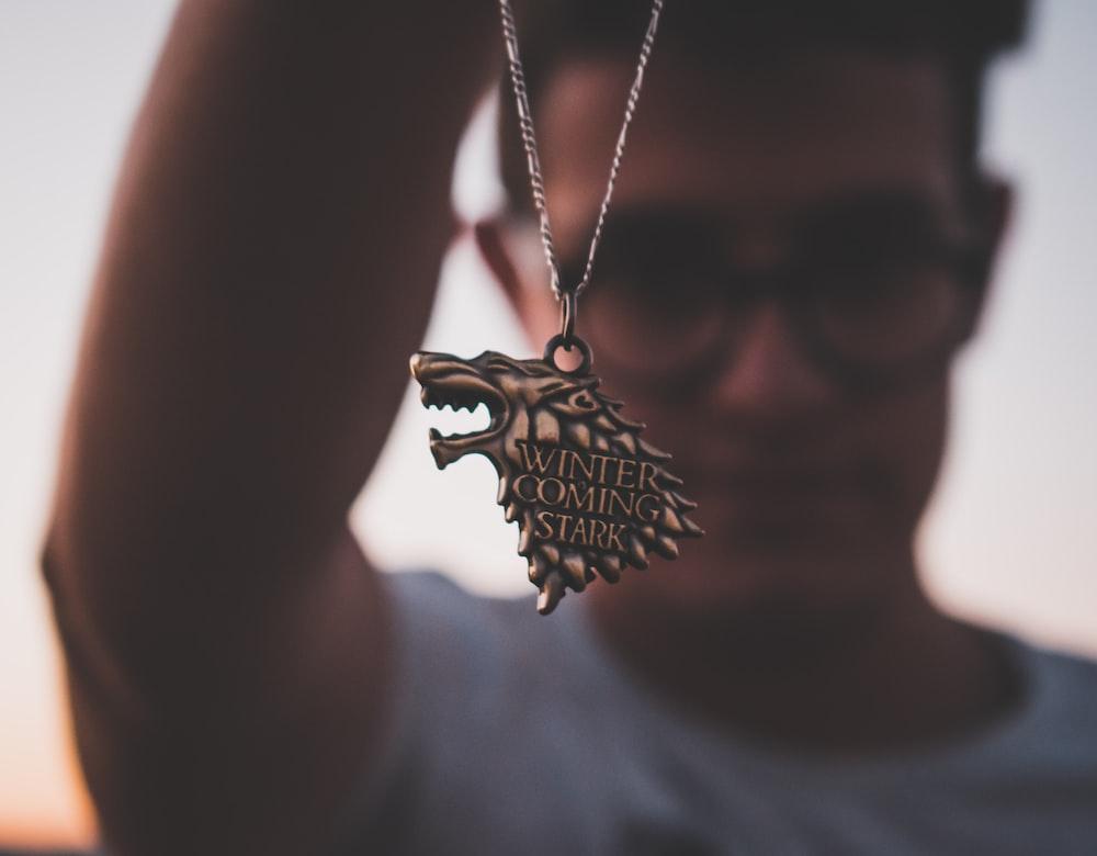 silver-colored Winter Coming Stark pendant necklace