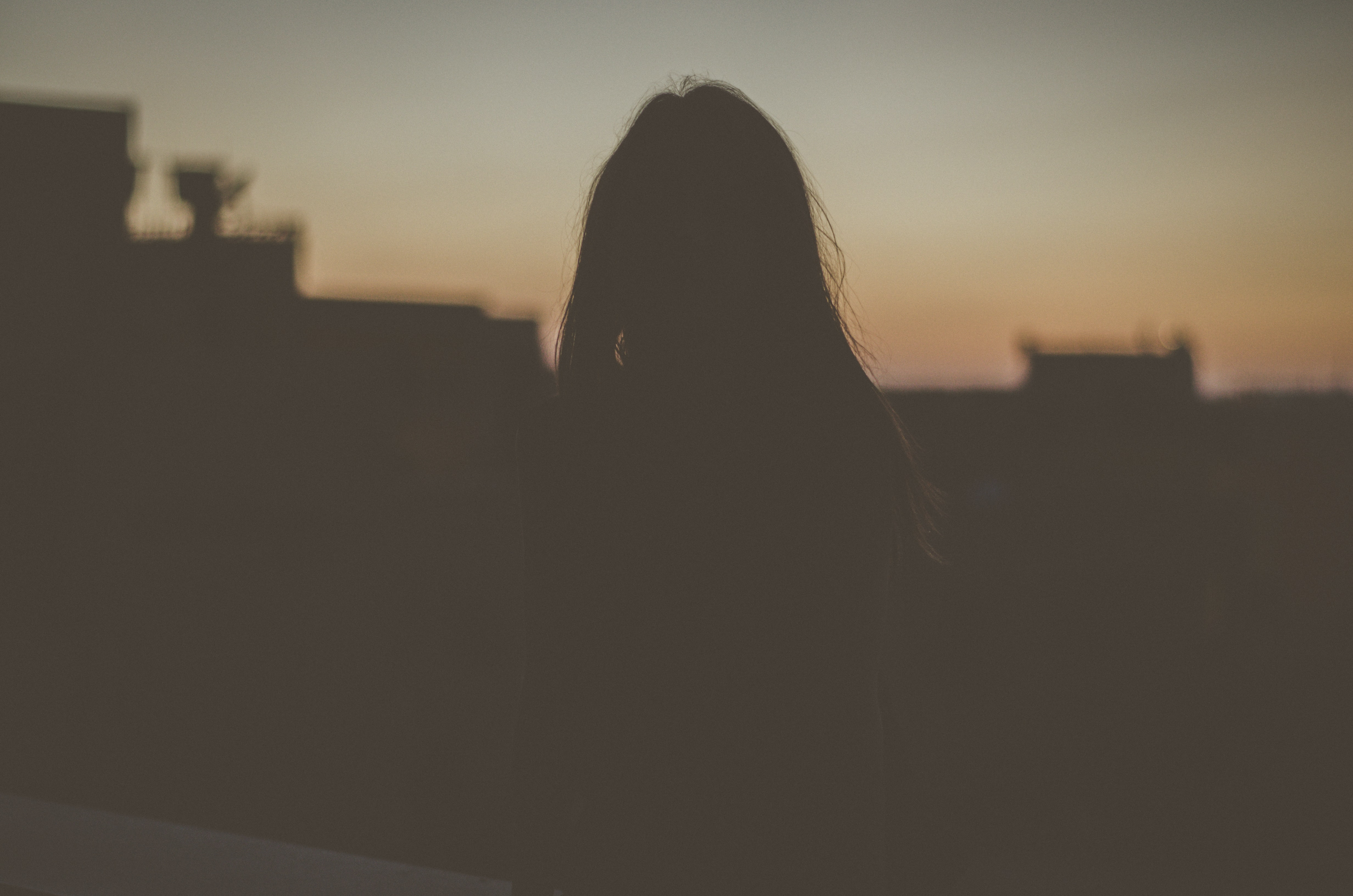 silhouette of woman standing