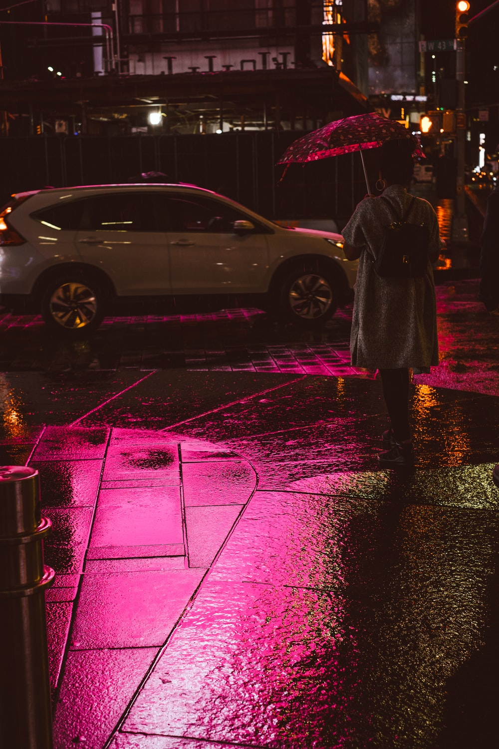 person holding umbrella while walking