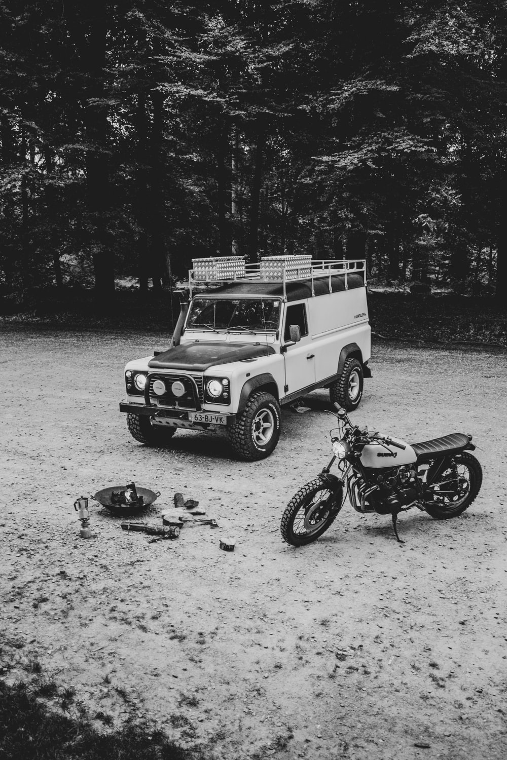 grayscale photography of SUV and motorcycle