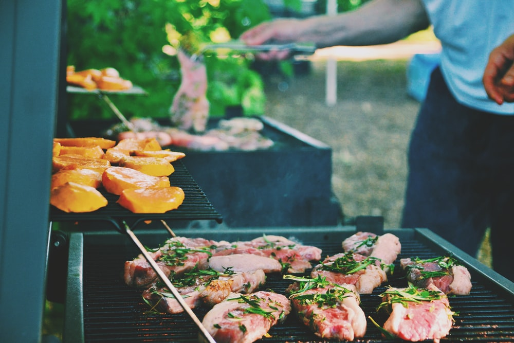 person grilling meat