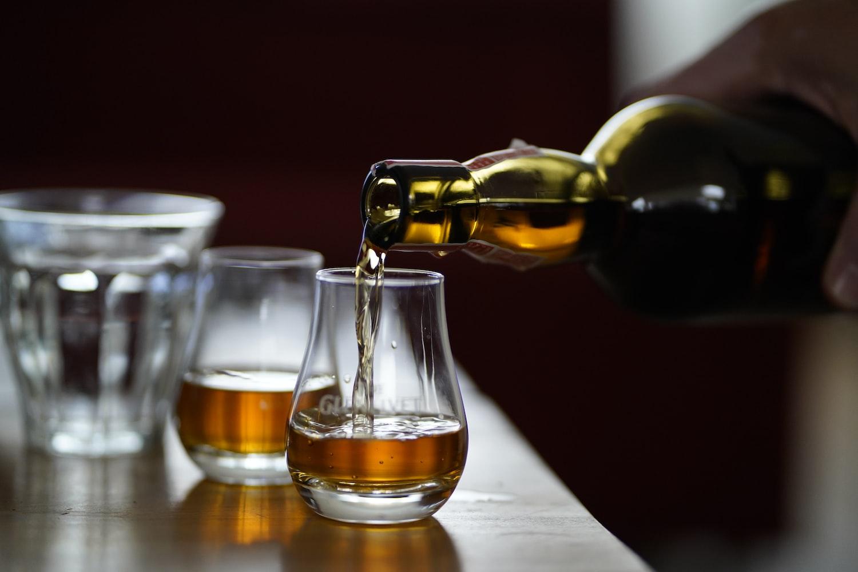 irish whiskey photo of person holding glass bottle