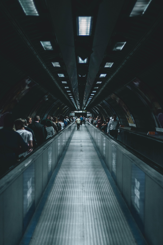 person waking on escalator