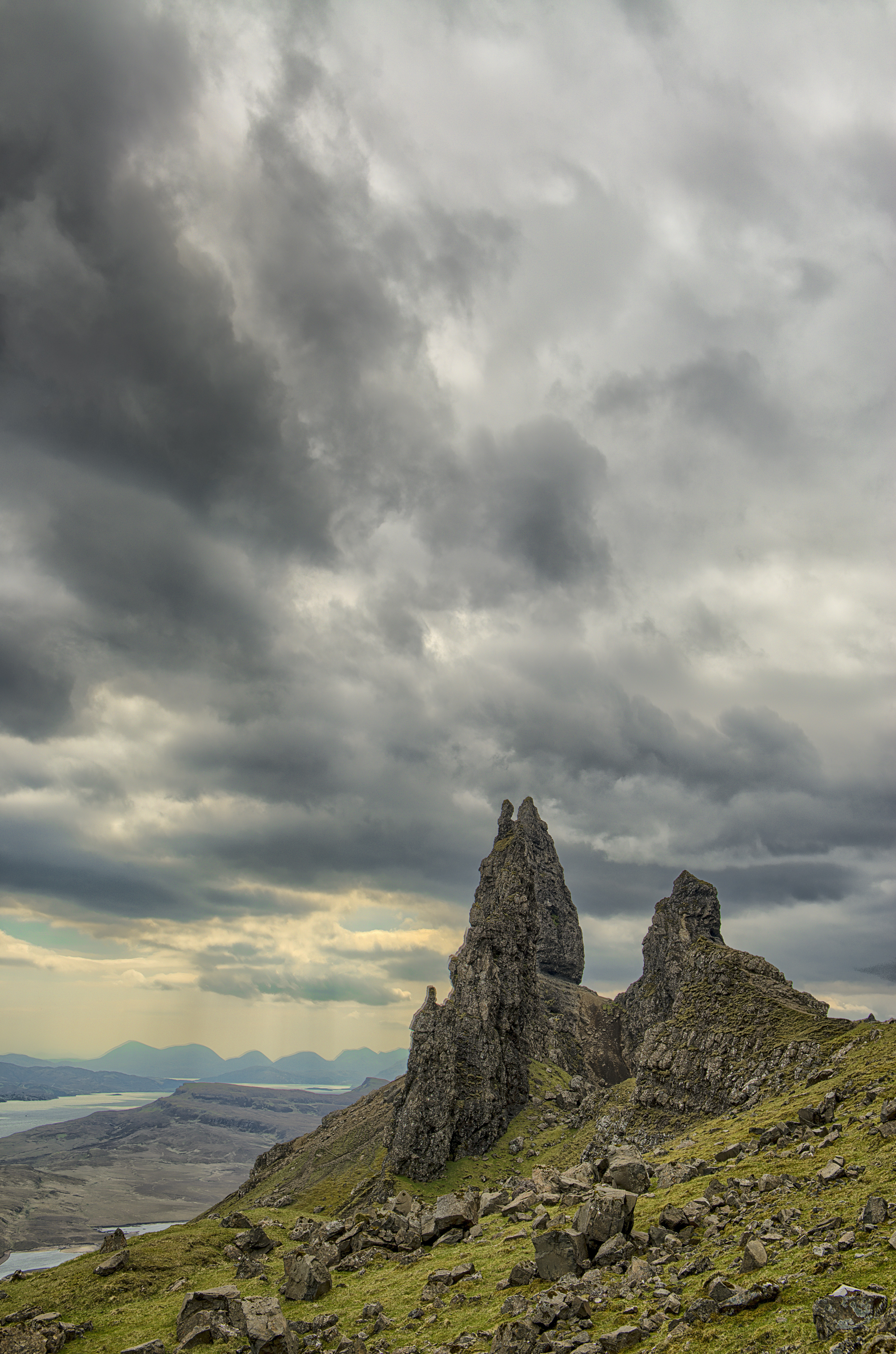 landscape photography of green and grey rocky hill under cloudy sky
