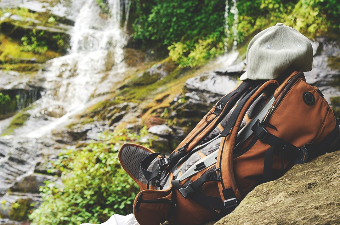 After hiking to the Catawba Falls in the Blue Ridge Mountains of North Carolina, I took this shot of a backpack on a rock close to the waterfall. The backpacker left his hat right on it and it seems to be looking at the waterfall as well…