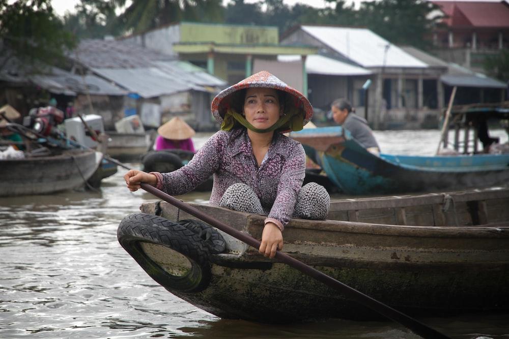 woman paddling on boat