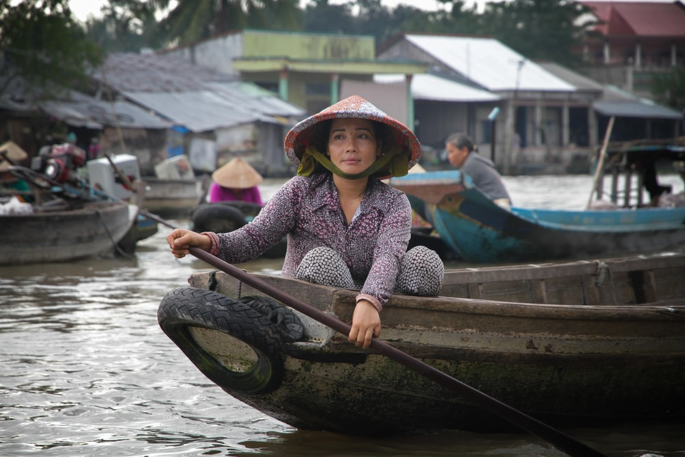 woman paddling on boat