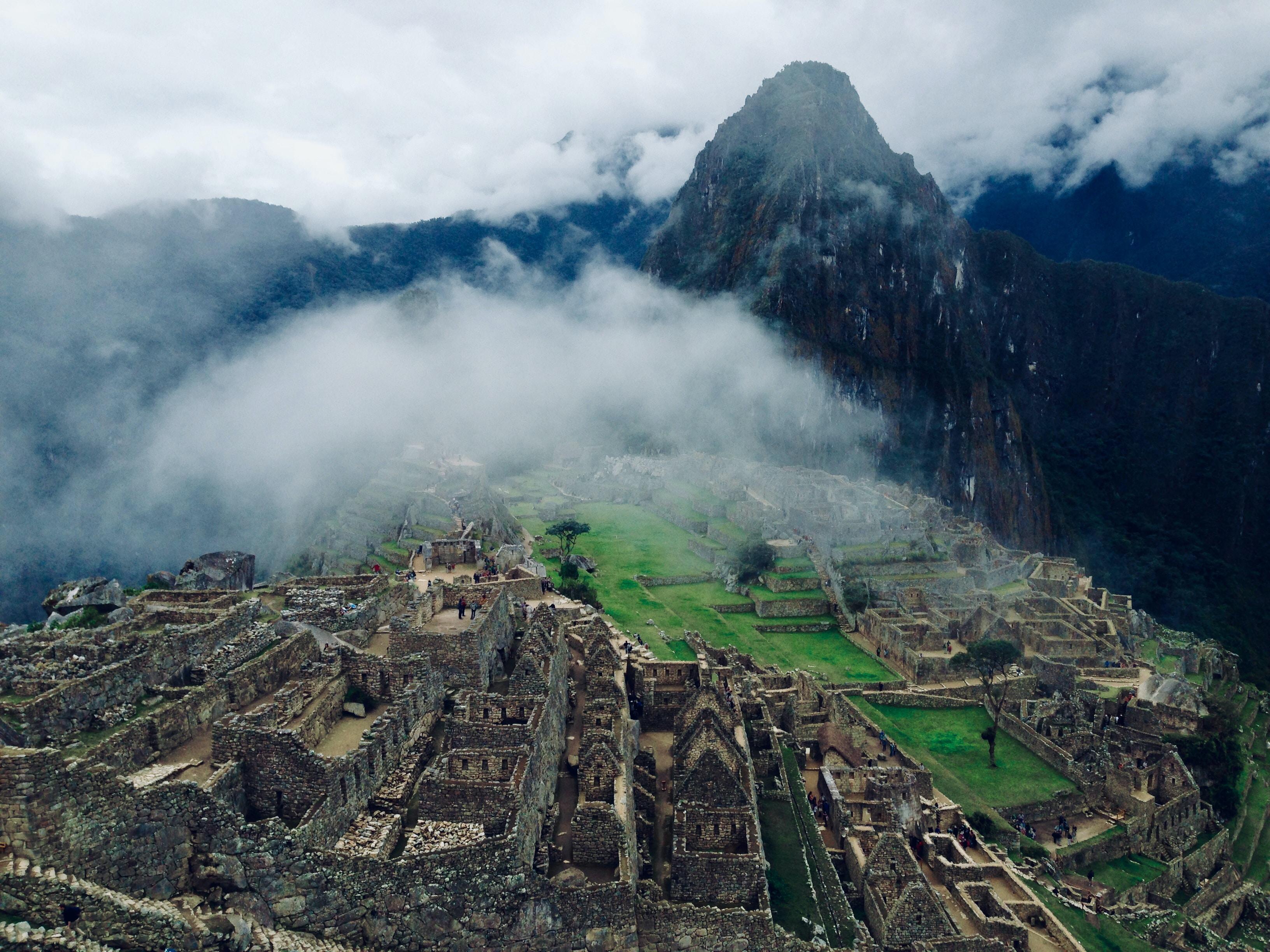 bird's-eye view of village in between mountain