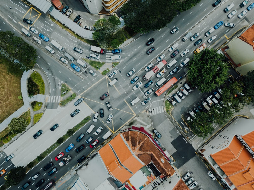 aerial view of cars passing on road near buildings