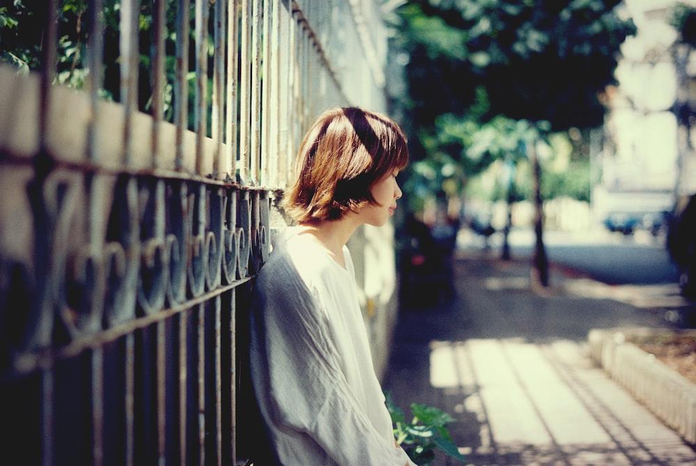 woman lying on black steel wall
