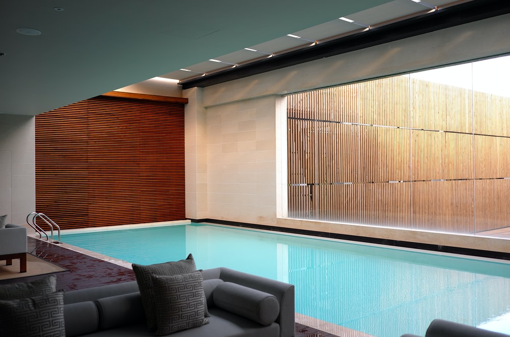 two gray sofas beside pool in room