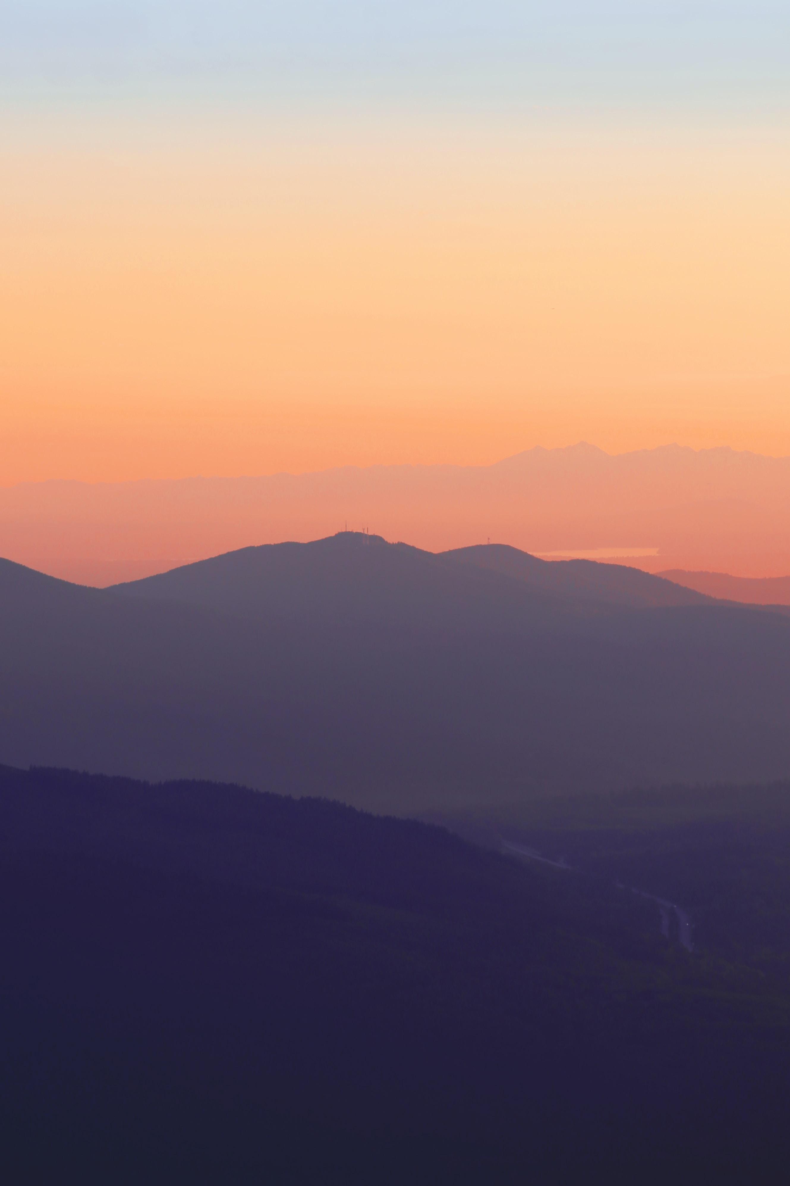 silhouette of mountain photo taken during sunset
