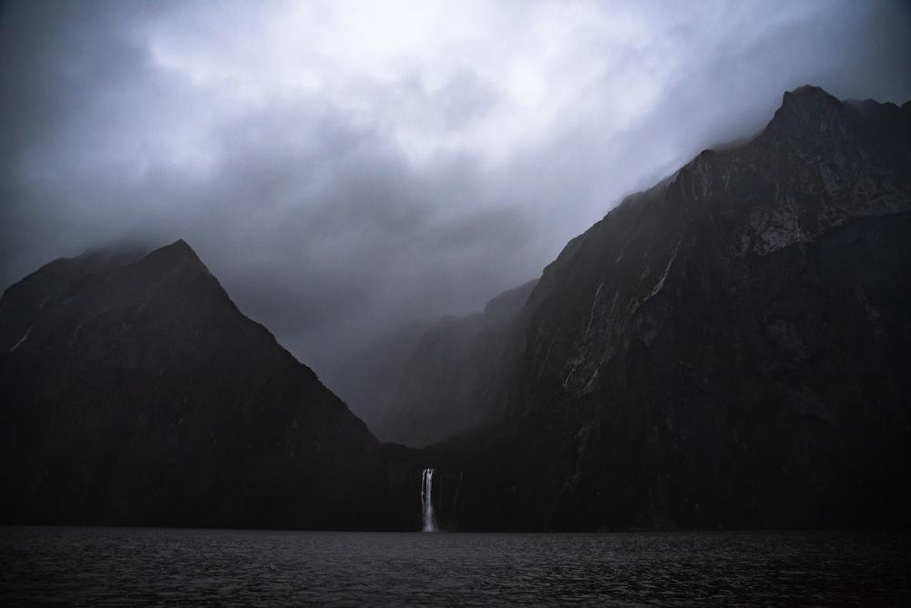 waterfalls in mountain near ocean