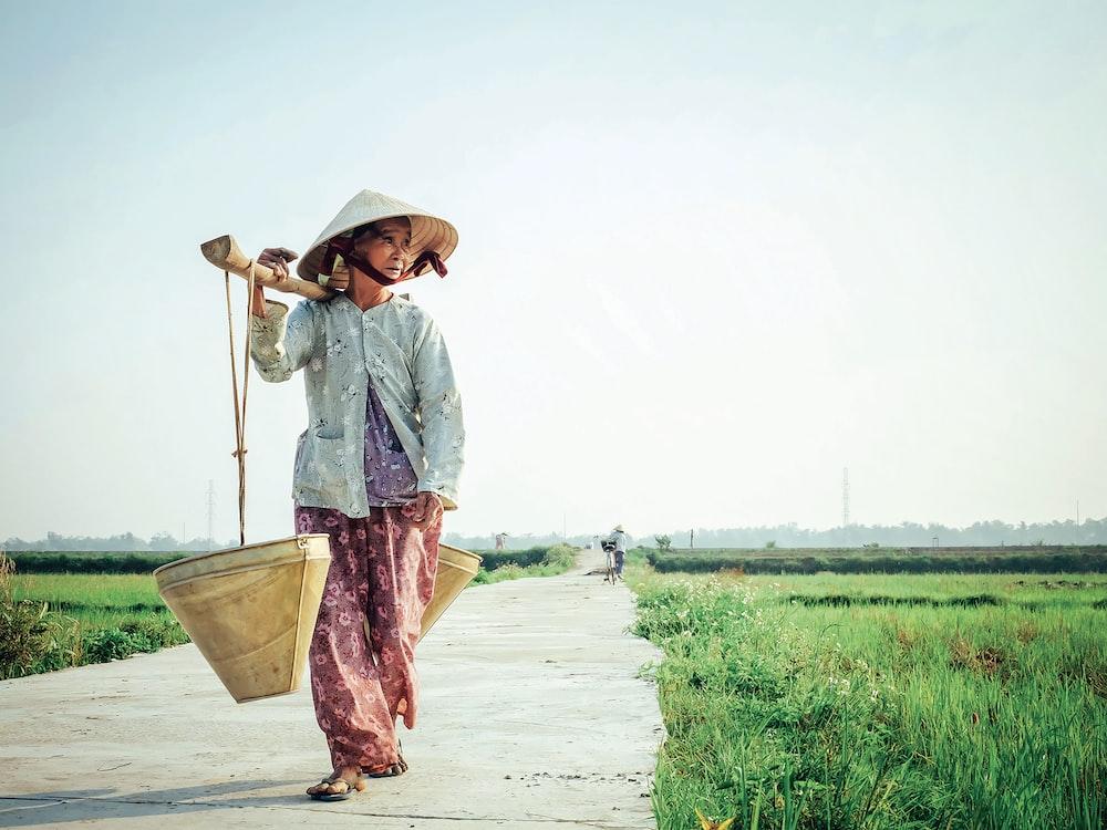 woman carrying basket on her shoulder