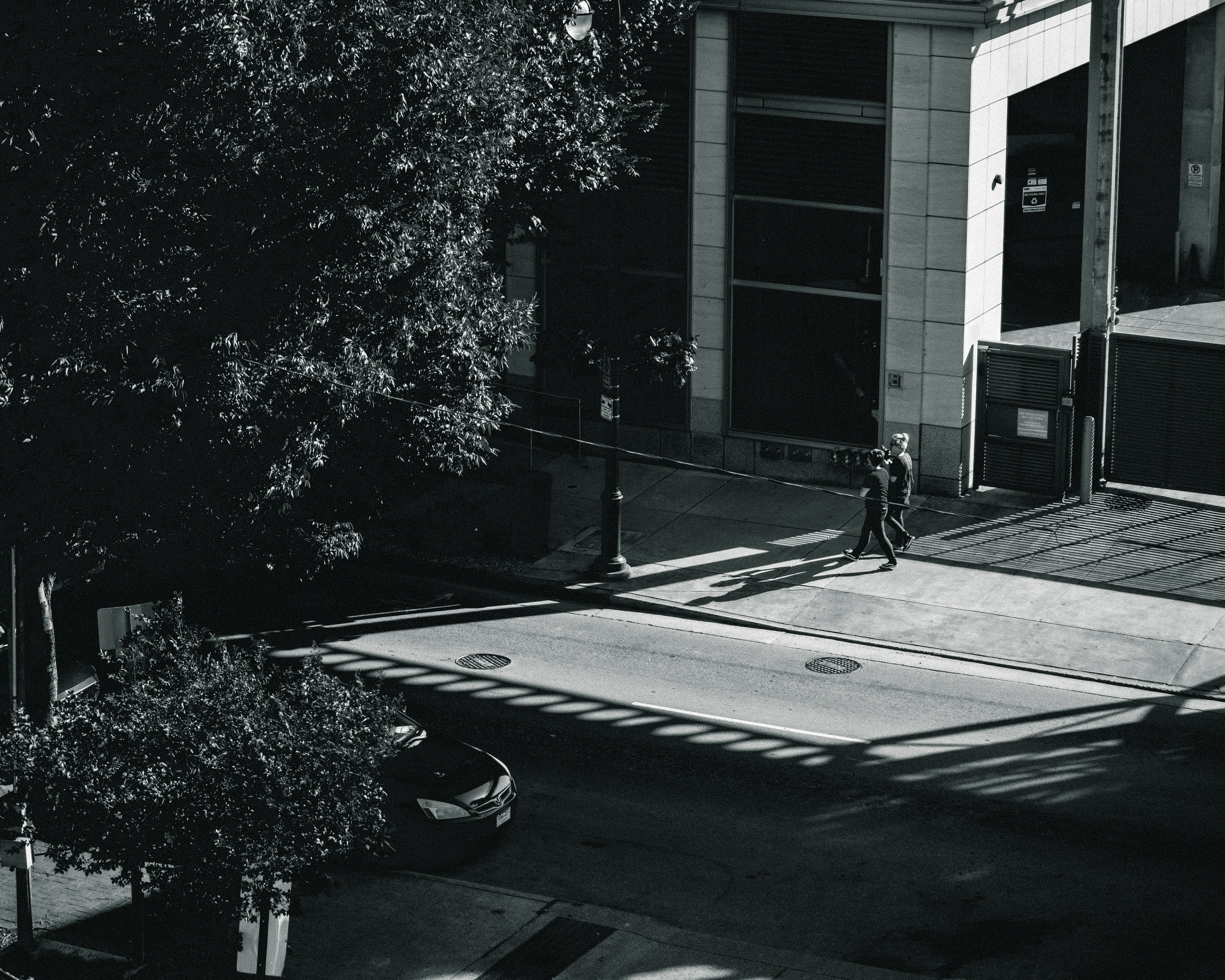 grayscale photo of people walking on road