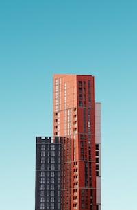 orange and black high rise building