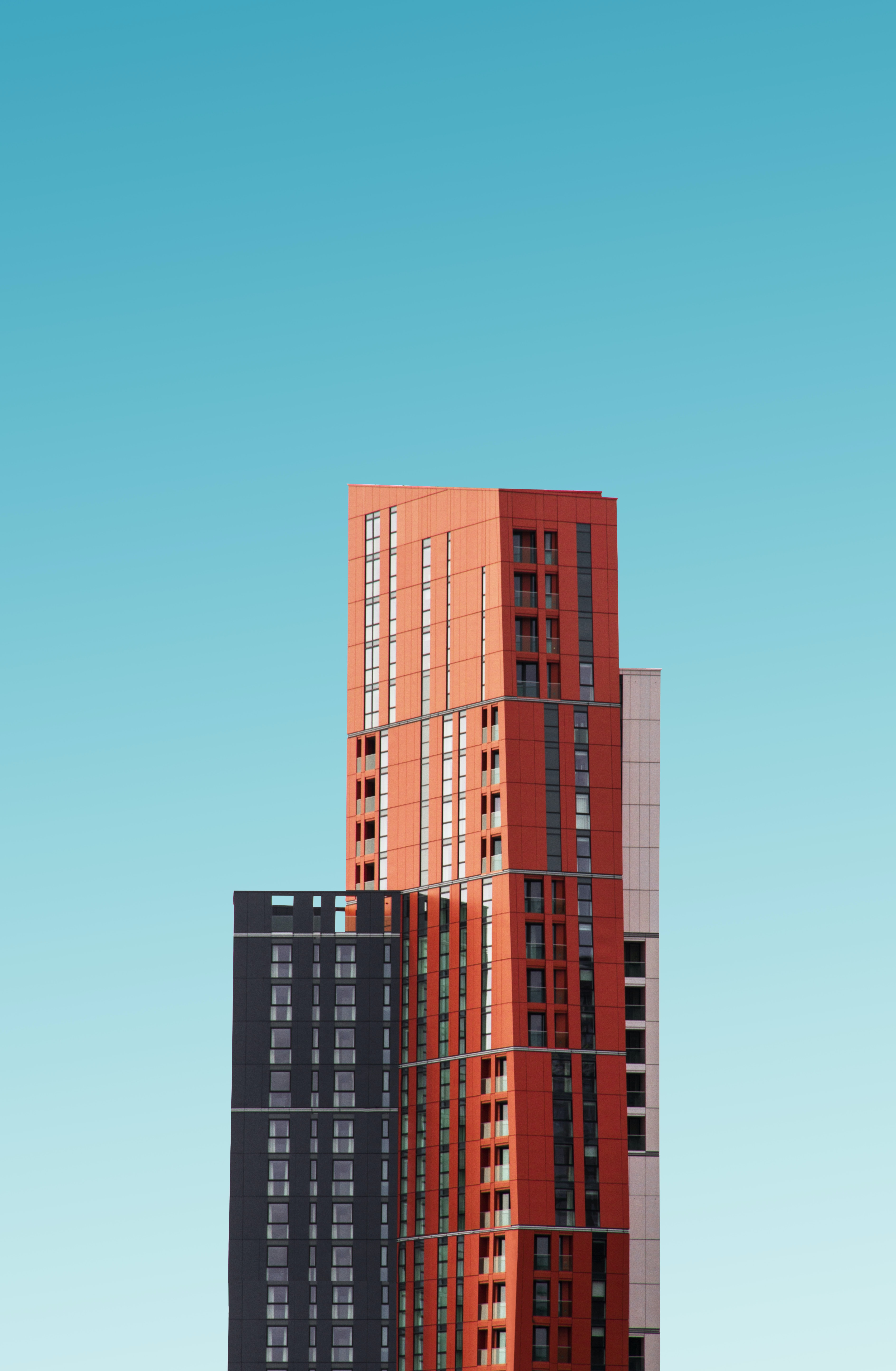 orange and black high rise building