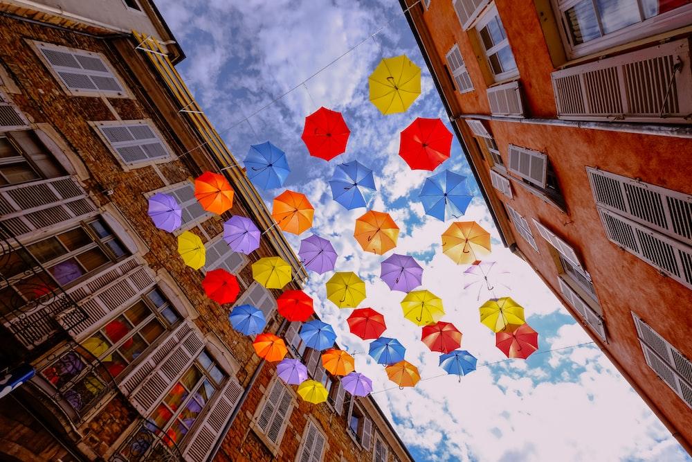 umbrella hanging beside buildings