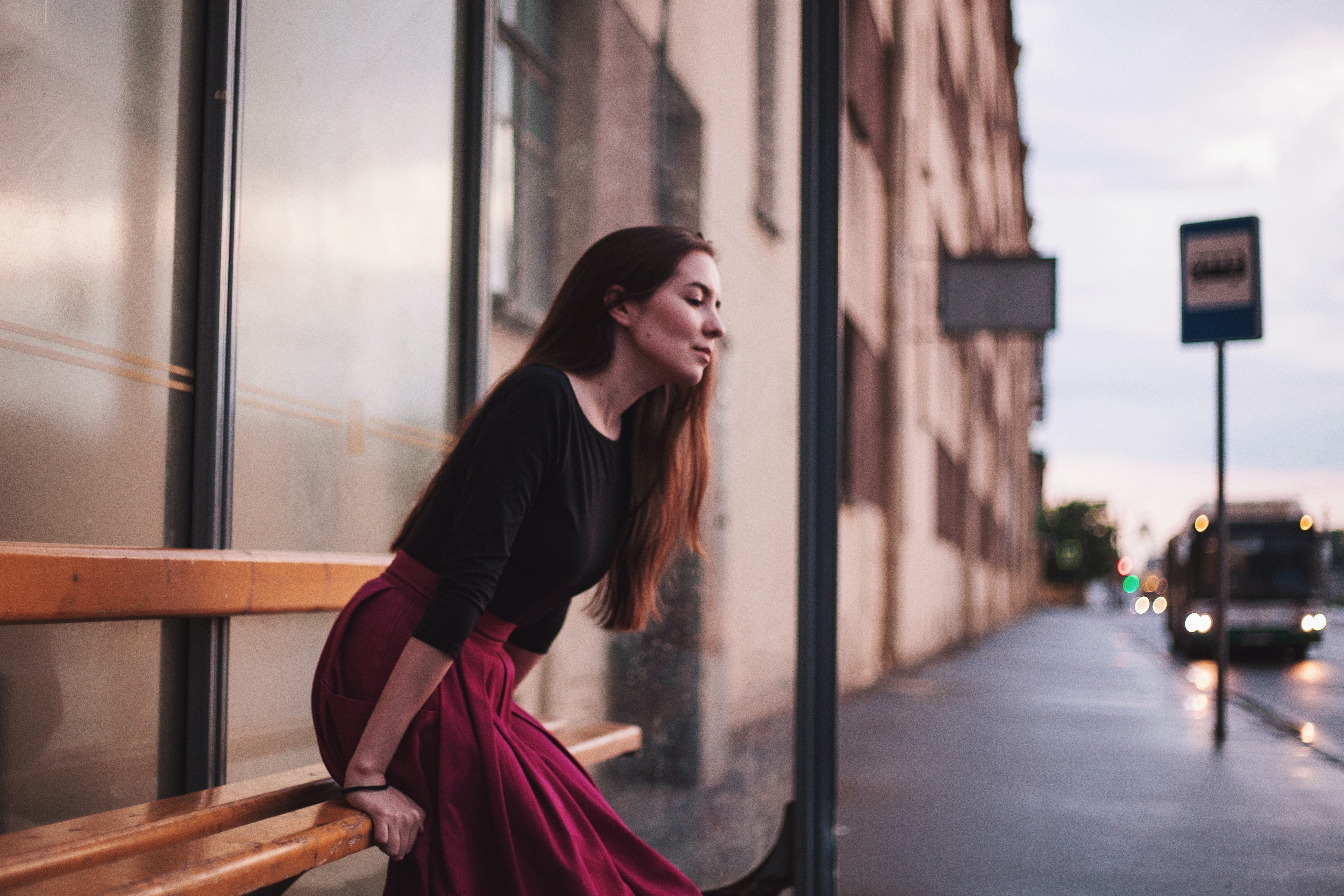photography woman sitting on bench near outdoor post lamp