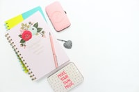 pink notepad with metal cases