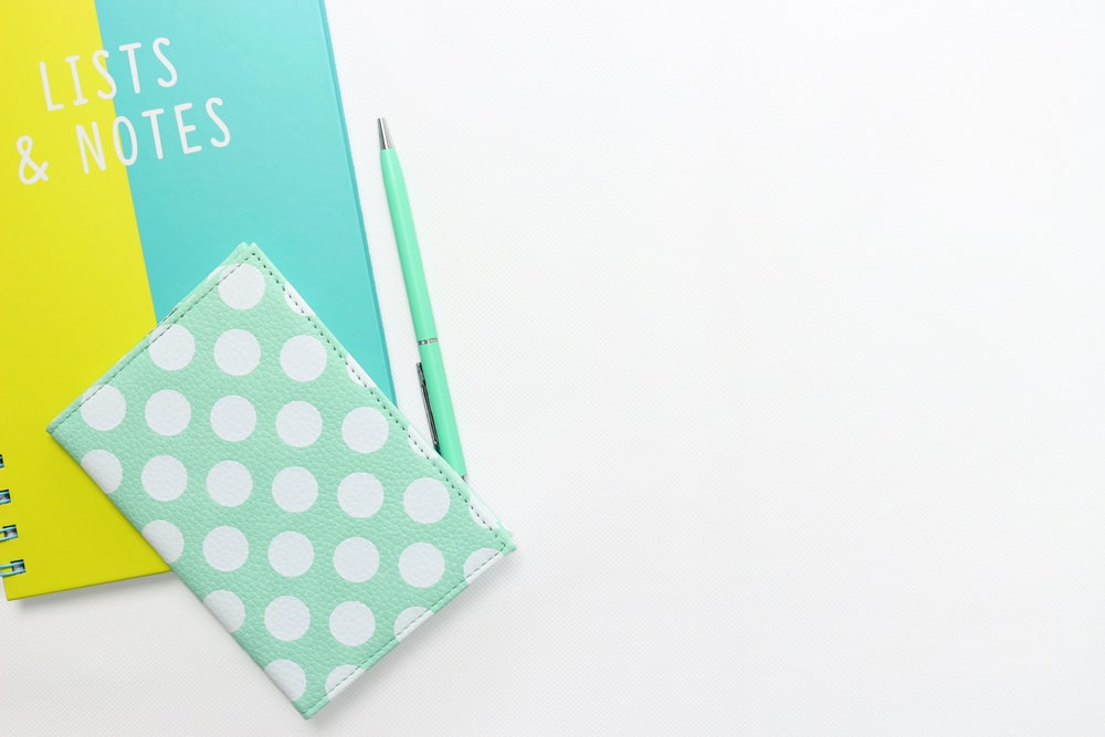 teal and white polka-dot wallet on table