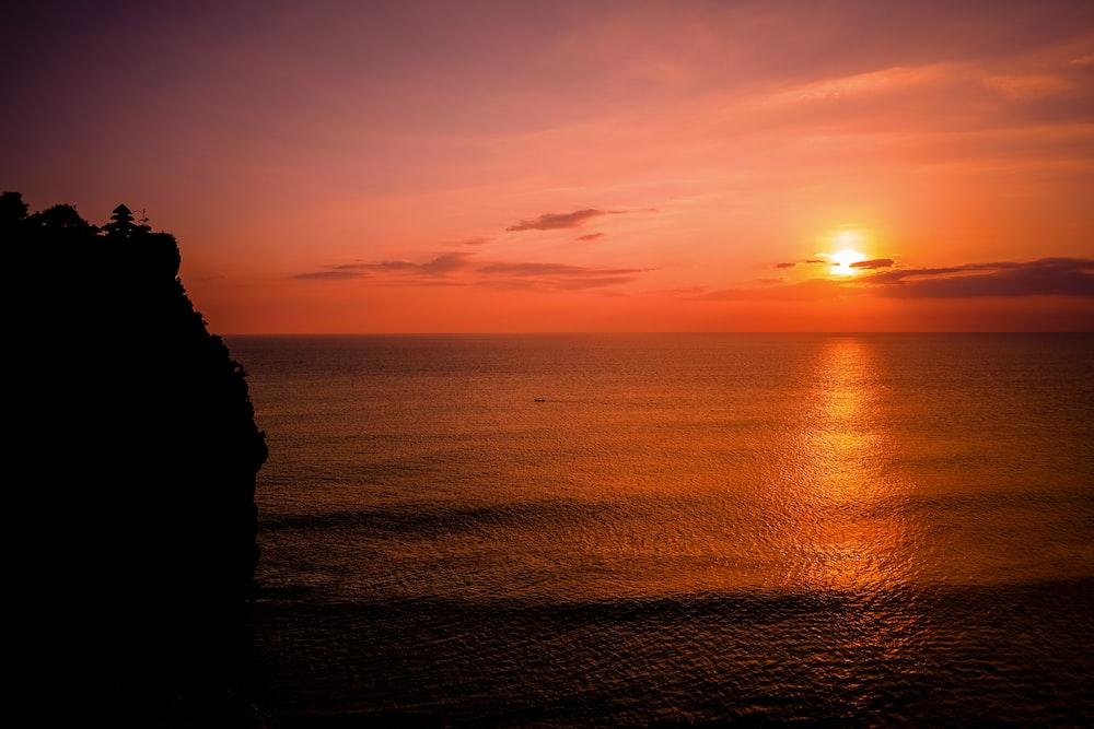 silhouette of seashore mountain