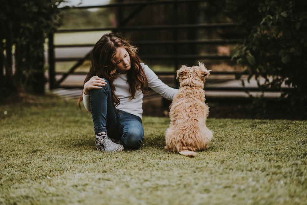 girl petting dog