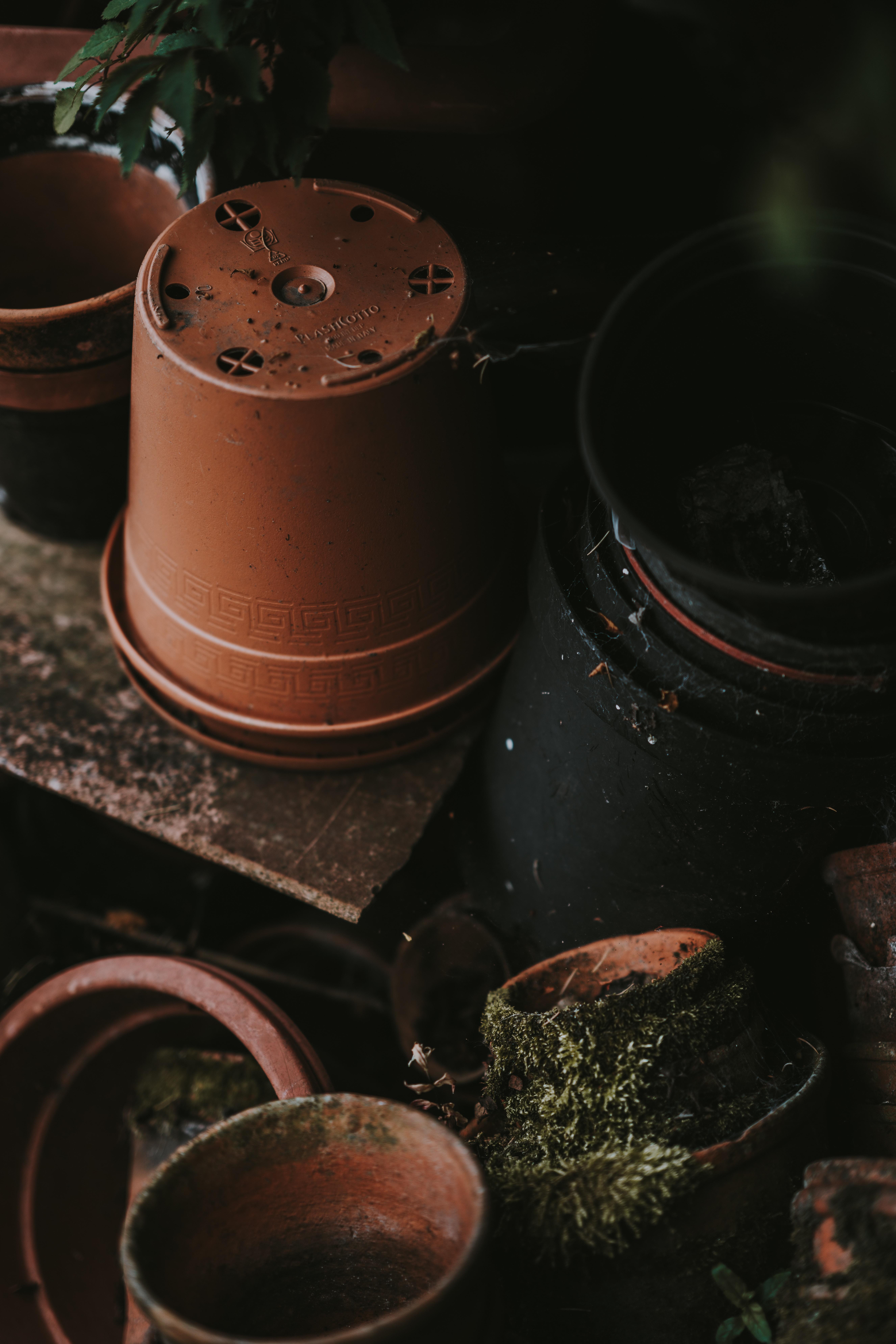 brown flower pots on brown wooden shelf