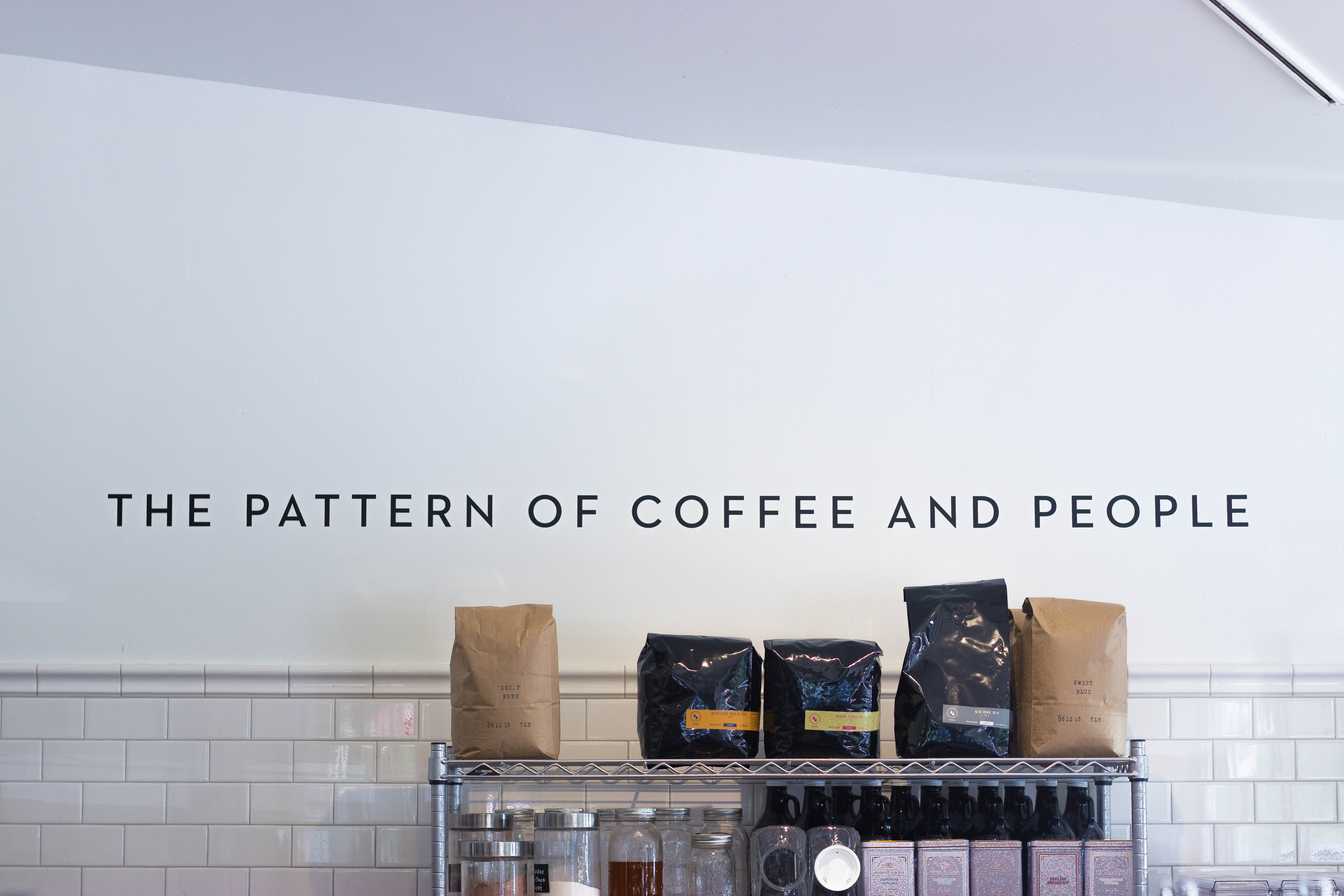 five assorted-brand coffee bags on stainless steel rack