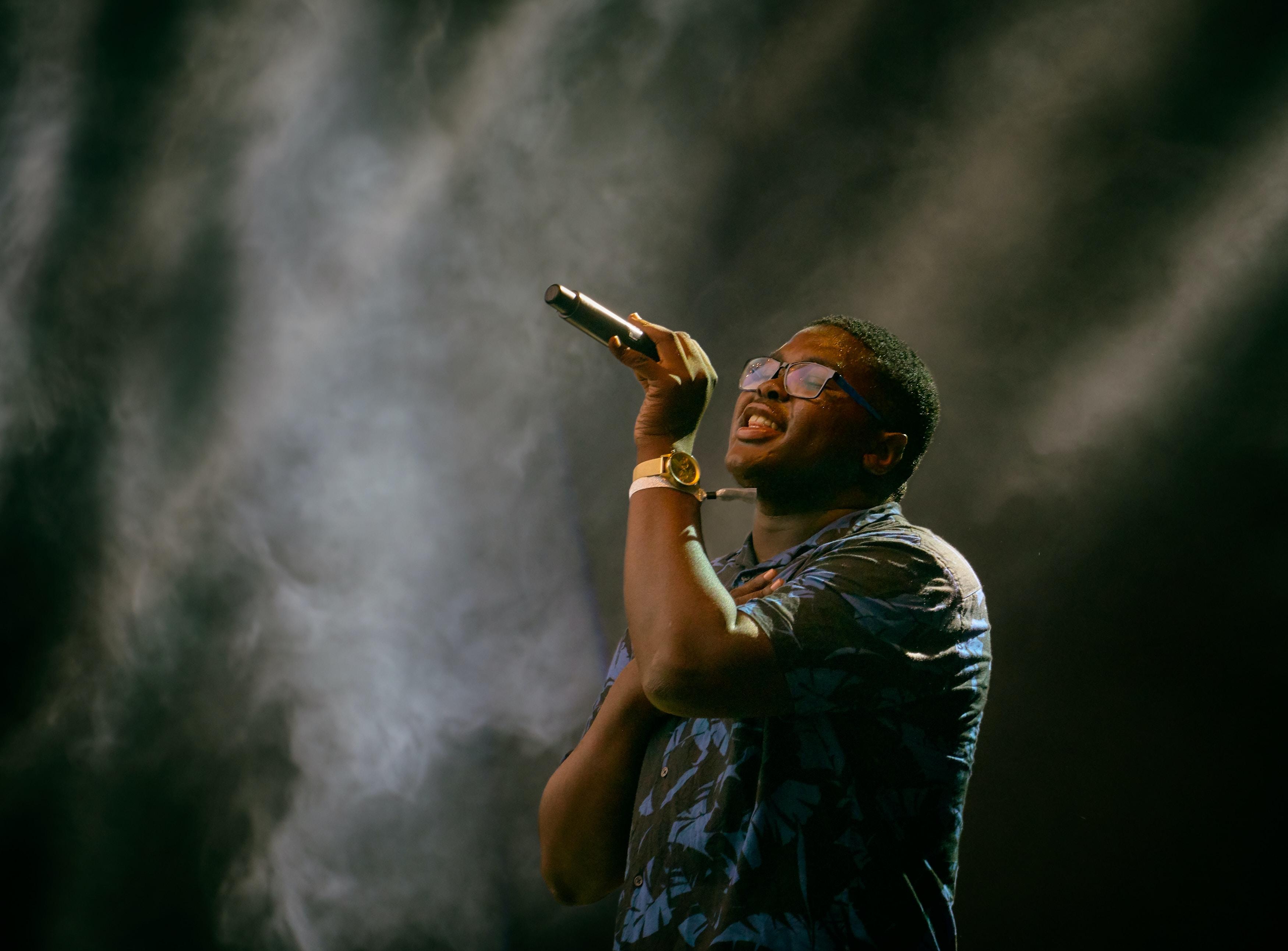 man holding microphone singing