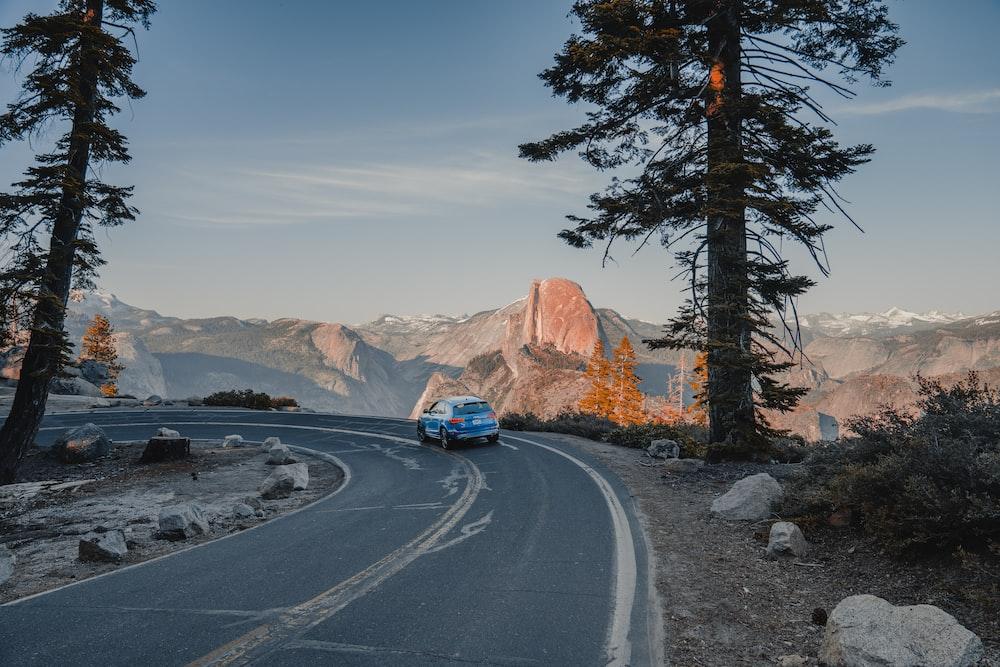 vehicle speeding on road at daytime