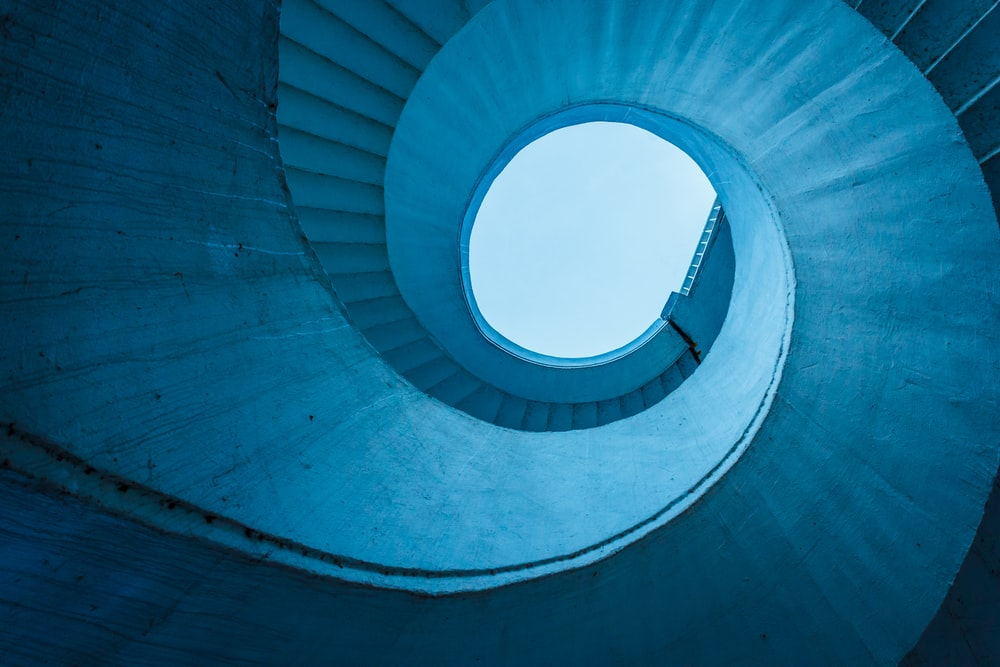 architectural structure photography of spiral stairs