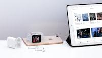 silver iPad near white Apple AirPods