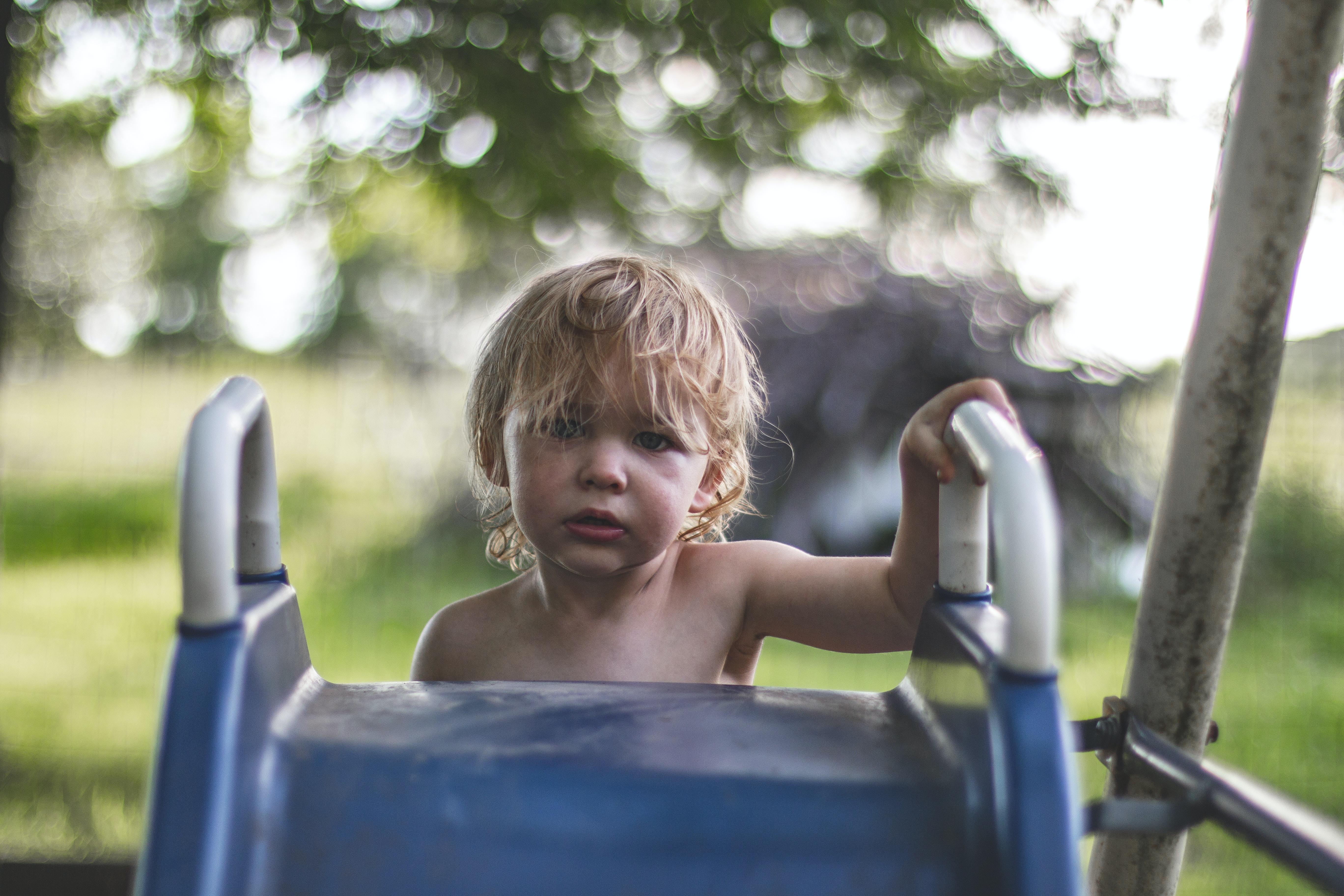 children climbing on slide