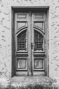 grayscale photo of door