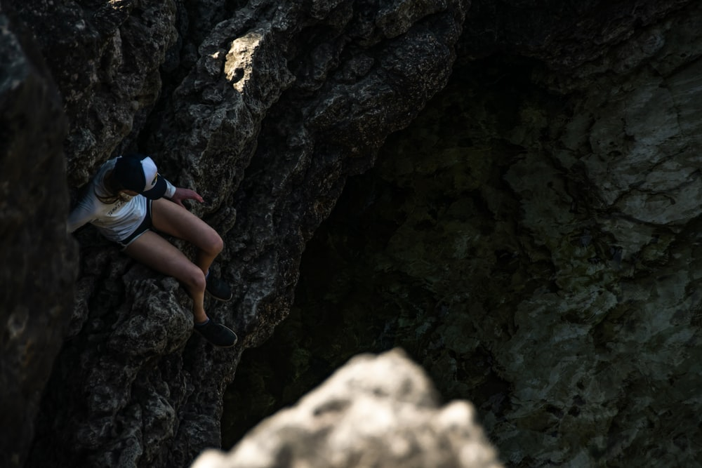 person going down on rock formation